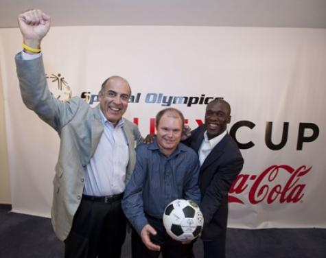 Muhtar Kent, Chairman and CEO, The Coca-Cola Company, and SpeciaI Olympics International board member; Ben Haack, Special Olympics Australia athlete; and Clarence Seedorf of AC Milan. Photo courtesy Special Olympics.