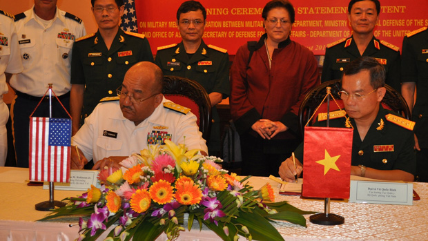 U.S. Navy Surgeon General Vice Admiral Adam M. Robinson Jr. and Vietnam's Military Medical Director Colonel Vu Quoc Binh sign the Statement of Intent on Medical Cooperation, August 1 in Hanoi.