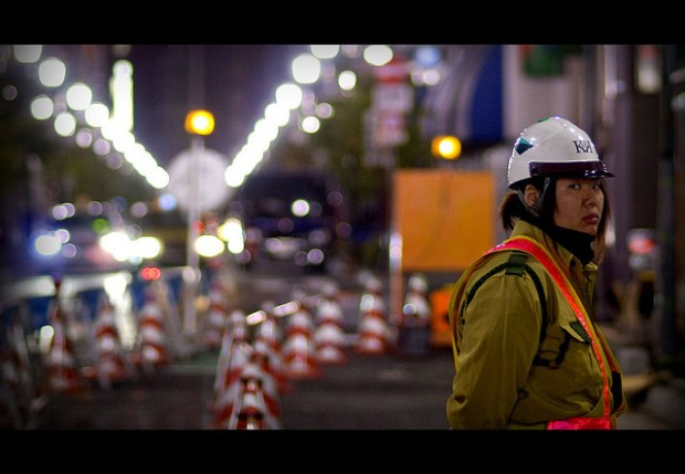 Woman working nightshift for roadwork in Ginza, Tokyo. Women are less prevalent in the Japanese workforce. Source: JesseLeeCuizon's flickr photostream, used under a creative commons license.