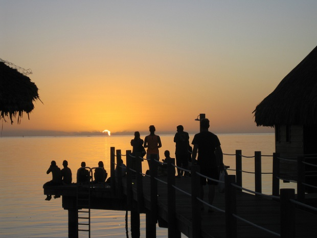 Is the sun setting on the French Pacific? Photograph taken on Mo'orea Island, 9 miles Northwest of Tahiti. Source: cariberry's flickr photostream, used under a creative commons license.
