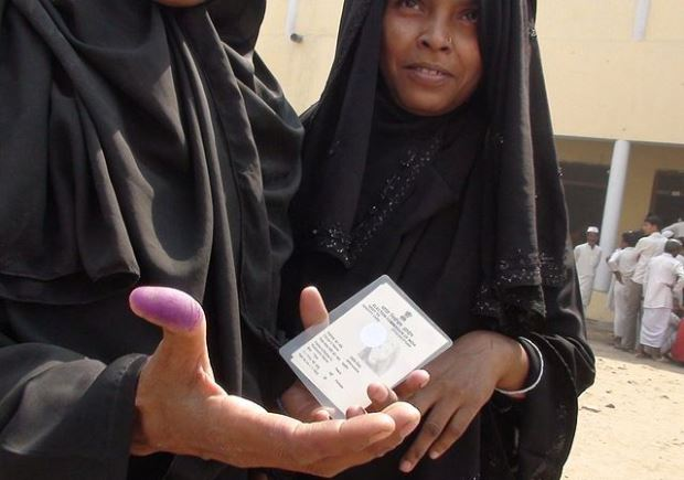 Minorities constitute a sizeable portion of India's electorate. In Varanasi, a burqa-clad woman shows her inked thumb after voting.Source: