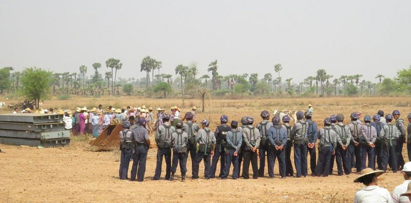Police in Letpadaung, Myanmar prepare to evict farmers to make way for a copper mine. Source: Burma Partnership's flickr photostream, used under a creative commons license.