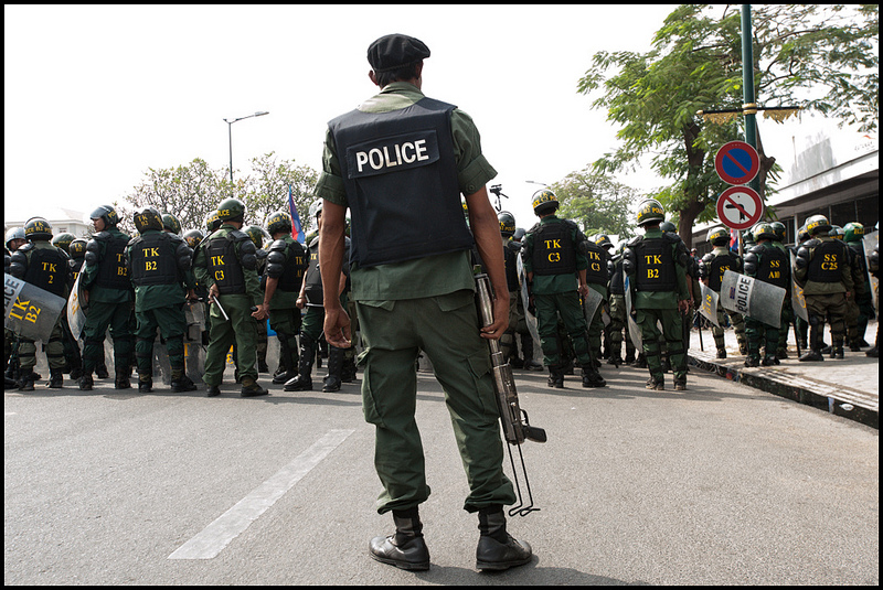 Police forces block a protest in Phnom Penh on December 30, 2013. Hun Sen's government subsequently ordered use of force to break up mass protests. Source: Luc Forsyth's flickr photostream, used under a creative commons license.