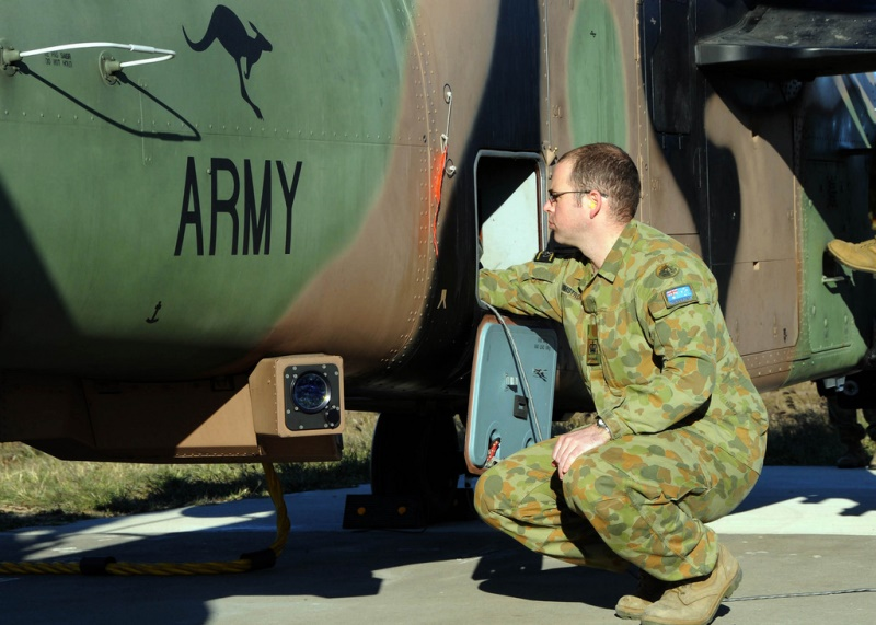 Australian Army Warrant Officer performs pre-flight maintenance. Australia's new white paper will shape the future of the Australian Defence Force and its capabilities to work with allies. Source: U.S. Pacific Fleet's flickr photostream, U.S. Government work