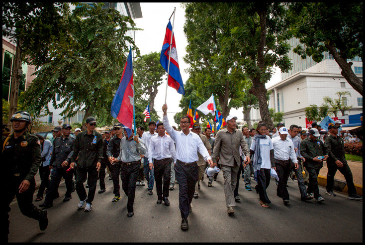 Sam Rainsy leading a protest march in Cambodia. The CNRP plans another demonstration this Saturday, March 29, 2014. Source: Luc Forsyth's flickr photostream, used under a creative commons license.