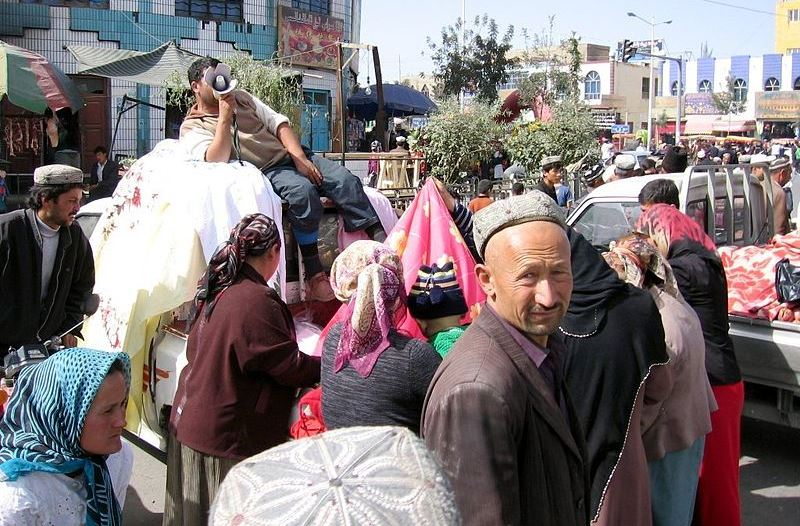 Uighurs on the move in Xinjiang, China. Source: Wikimedia, used under a creative commons license.
