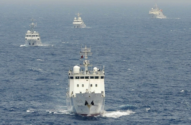 hinese surveillance ships sail in formation in waters claimed by Japan near disputed islands called Senkaku in Japan and Diaoyu in China in the East China Sea on April 23, 2013. Source: Times Asi flick photostream, used under a creative commons license.