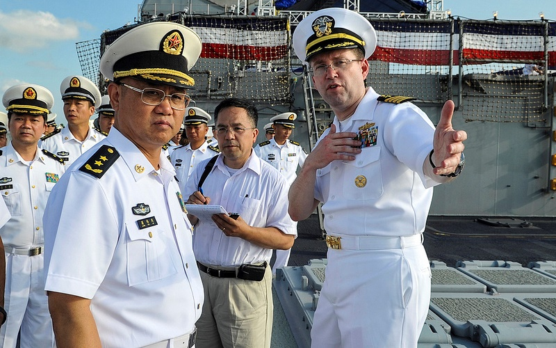Capt. James T. Jones, commanding officer of the guided-missile cruiser USS Shiloh, right, describes his ship to Commander of People's Liberation Army (PLA) Navy's South Sea Fleet (SSF), Vice Adm. Jiang Weilie. China's assertiveness in Asia has U.S. allies and partners concerned. Source: U.S. Pacific Fleet's flickr photostream, U.S. Government Work.
