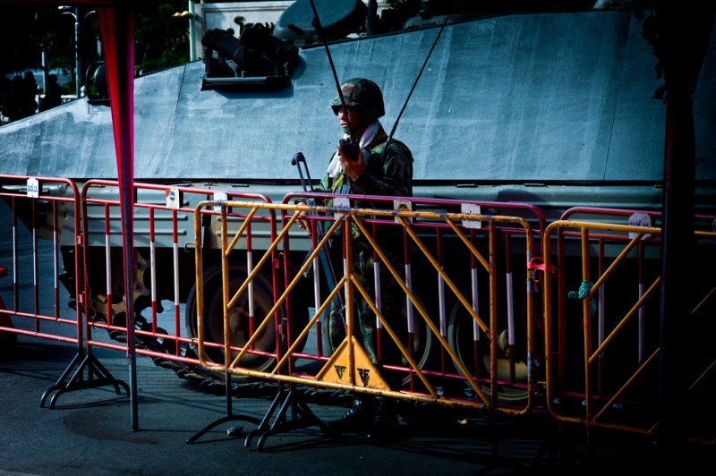 A Royal Thai Army Signal Corps soldier awaits orders at an intersection in Bangkok. Source: null0's flickr photostream, used under a creative commons license.