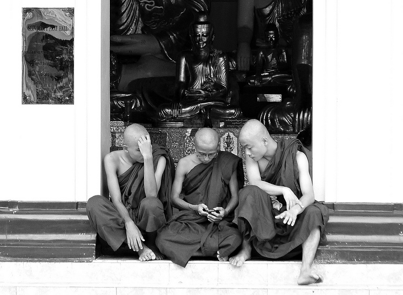 Monks in Yangon, Myanmar examine a cell phone. Source: NgoPhotographyPLZ's flickr photostream, used under a creative commons license.