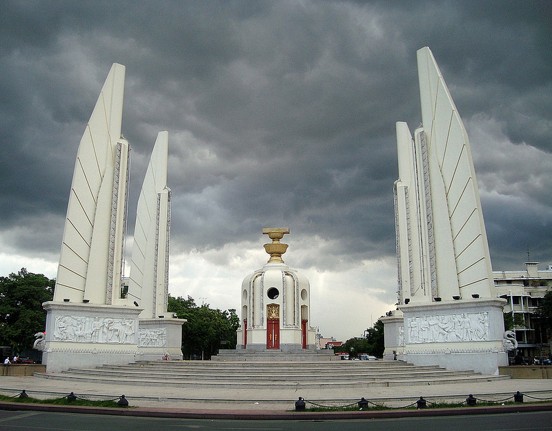 Storm clouds over the Democracy Monument in Bangkok, Thailand. Source: PaultheSeeker's flickr photostream, used under a creative commons license.