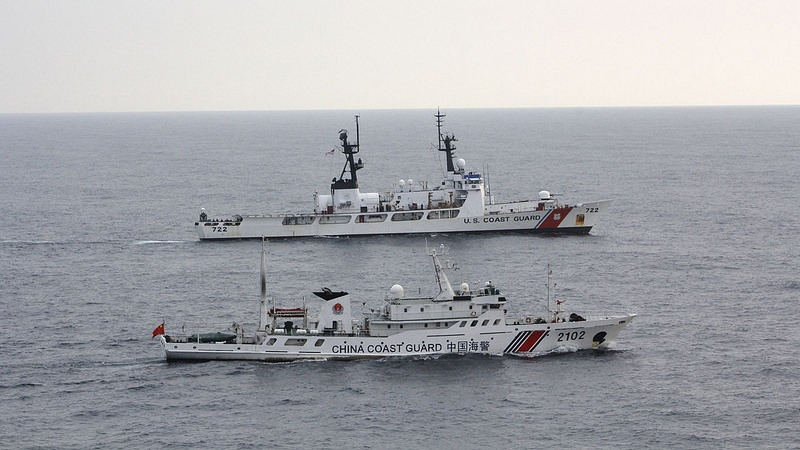 U.S. and China Coast Guard vessels interdicting illegal fishing in the North Pacific Ocean. A multilateral, paramilitary response in the South China Sea led by the United States could help deter conflict between China and its neighbors Vietnam and the Philippines. Source: Coast Guard News, U.S. Government Work